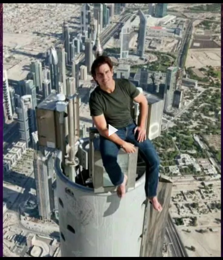 Tom Cruise Sitting At The Top Of The Tallest Building In