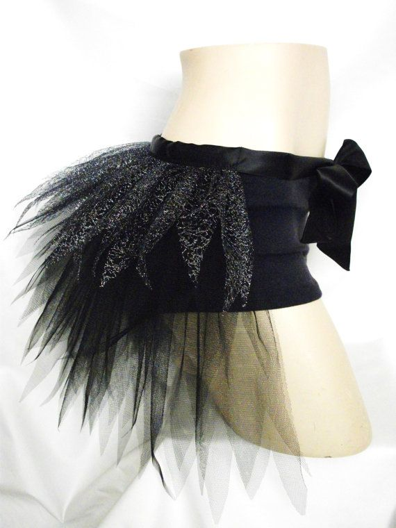 Hey, I found this really awesome Etsy listing at http://www.etsy.com/listing/117717526/black-sparkly-silver-half-tutu-bustle