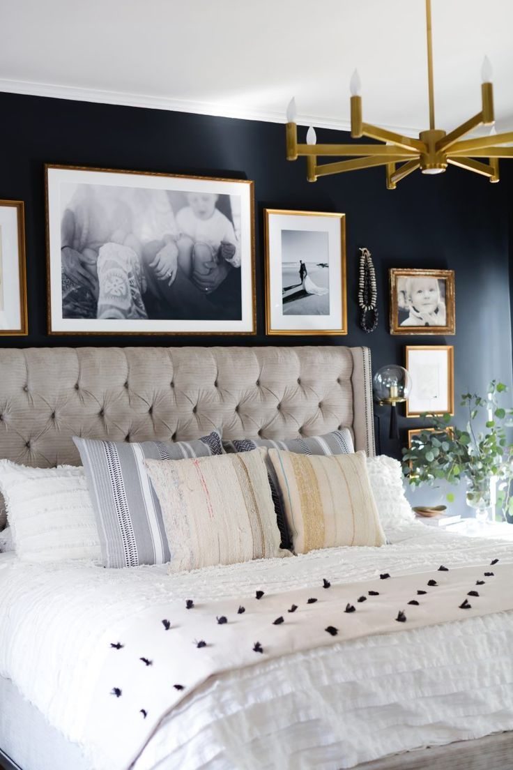 Black and brass accents give this master bedroom reveal a moody edge!