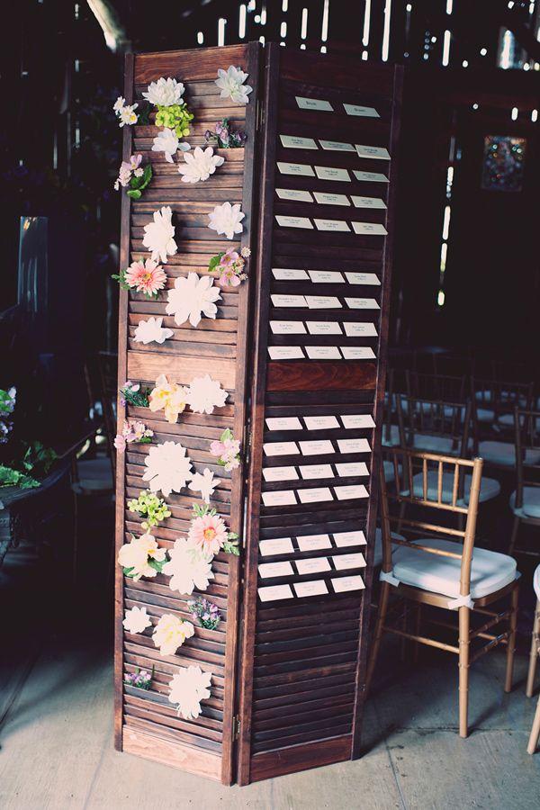 display escort cards on window shutters // photo by Joyeuse Photography http://ruffledblog.com/bohemian-barn-wedding #seatingchart #escortcards #weddingideas