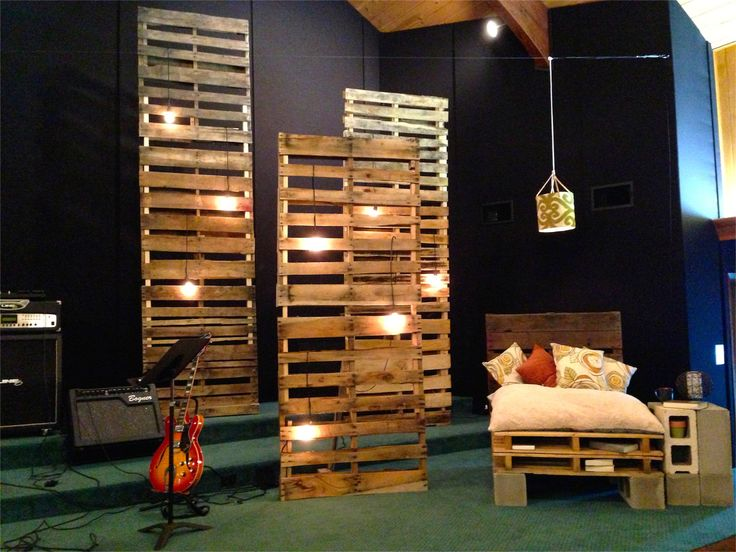 Tanya Runyan from Harvest Church in Tyler, TX brings us this creative set piece designed with pallets. Materials: Pallets: Free (from a local hardware store) Cinderblock: Free Lighting: $160 including bulbs Pillows/decor:$100 Total Budget $260. Pallets: They stacked 3 pallets high, inserted a 2x3 for bracing, and anchored them to the ground. Lighting: They daisy chained the lighting with 16 gauge lamp wire into a dimmer pack and 40Watt light bulbs. Bench: Sawzalled 3 pallets in half and…
