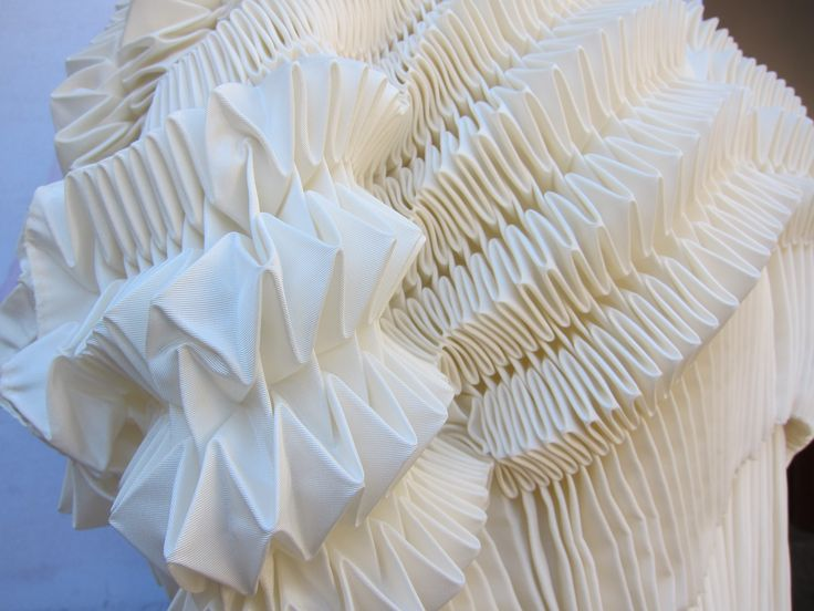 One of the amazing pieces produced during the four-week Arts of Fashion Summer MasterClass in Paris. The women's wear incorporated intricate pleating techniques that students learned from working under master pleat-maker Gerard Lognon.
