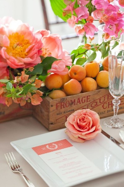 centerpieces in fruit crates (maybe for the dining &/or buffet tables?), love the mix of florals & fruits