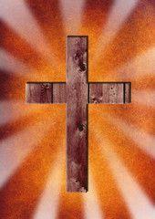 Hölzernenes Kreuz vor abstraktem Hintergrund