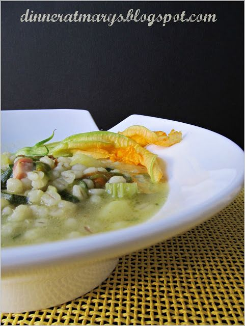 Soup zucchini flowers and barley with herbs, recipe Claudio Sadler