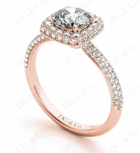 BRILLIANT CUT DIAMOND RING WITH PAVE SET DIAMONDS ON HALO AND DOWN THE SHOULDERS.