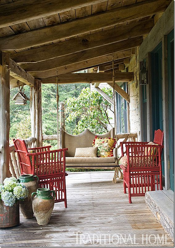 Log cabin porch via Traditional Home
