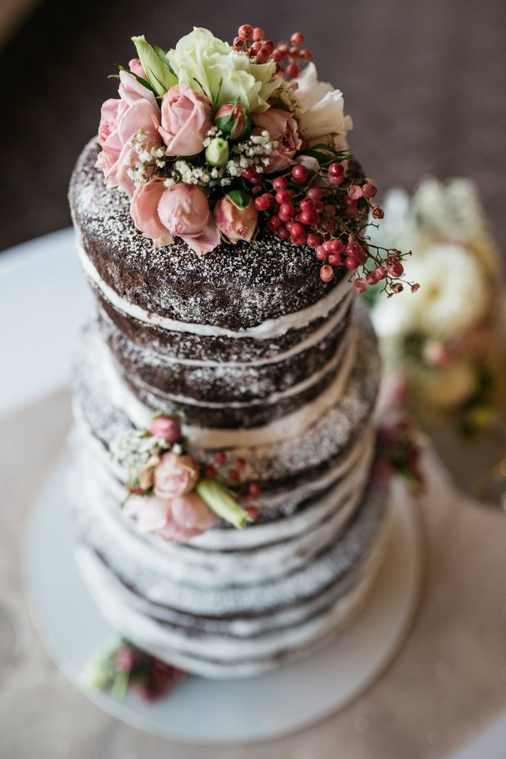 Naked Chocolate Mud Wedding cake. With fresh flowers and dusted with icing sugar