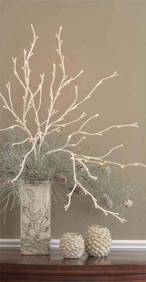 White branches with pine cones & greenery. Wrap a similar vase in either a scarf or paper to achieve the same look.