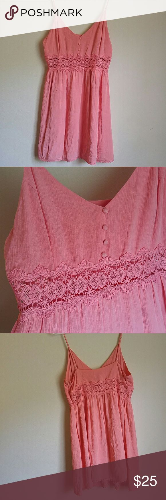 Forever 21 Size Large Coral Pink strappy Dress Beautiful preowned condition. Very good condition. Lovely see through lace crochet wait detailing. Really beautiful coral pink color. Size large. Zip up on the side and strap sleeves. Forever 21 Dresses Midi