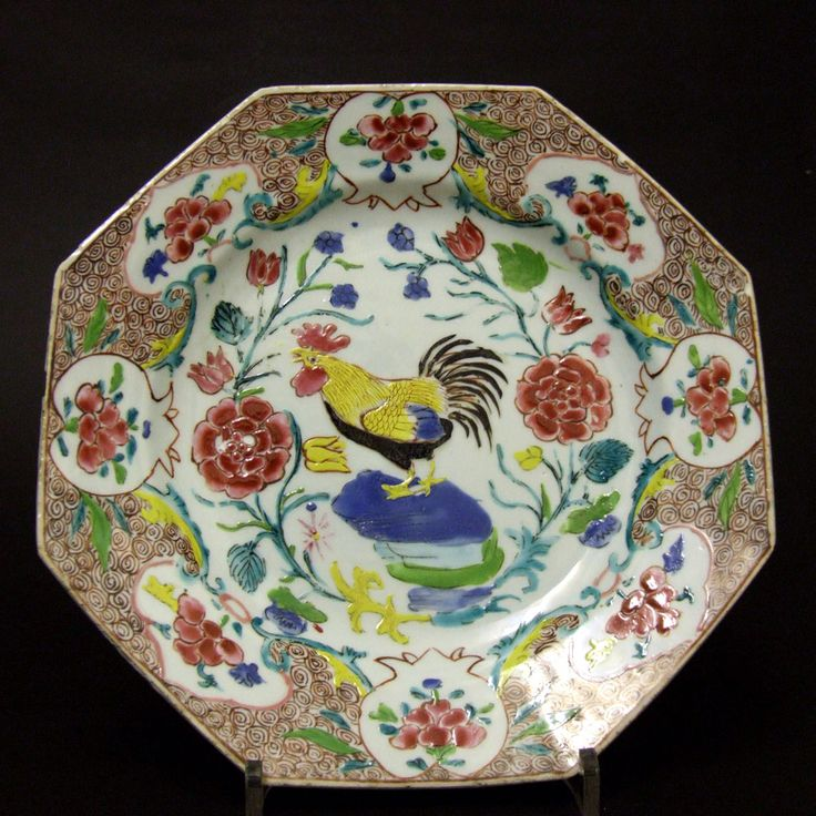 An 18th Century Chinese Export Porcelain Dish Decorated with Famille Rose Enamels, Early Qianlong Period c.1736-1750. This Octagonal Porcelain Dish is Painted in Bright Enamel Colours with a Large Cockerel Standing on Multicoloured Rocks Among Peony and other Flowers. The Border Contains Pomegranate Shaped Panels.