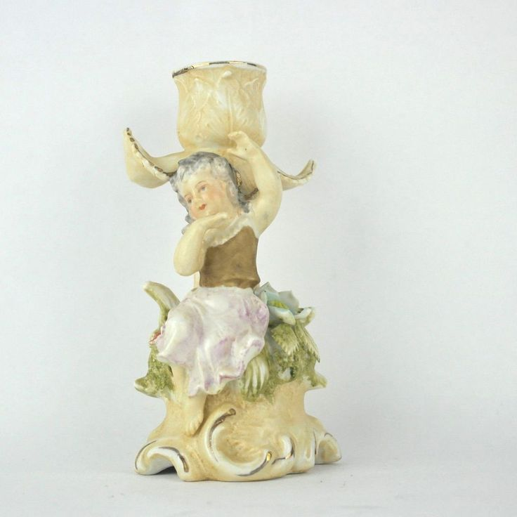 SOLD - Single matte or bisque porcelain ceramic candle stick holder features a seated girl cherub among flowers and leaves. #Vintage #MidCentury #CandleHolder #Wales #Japan