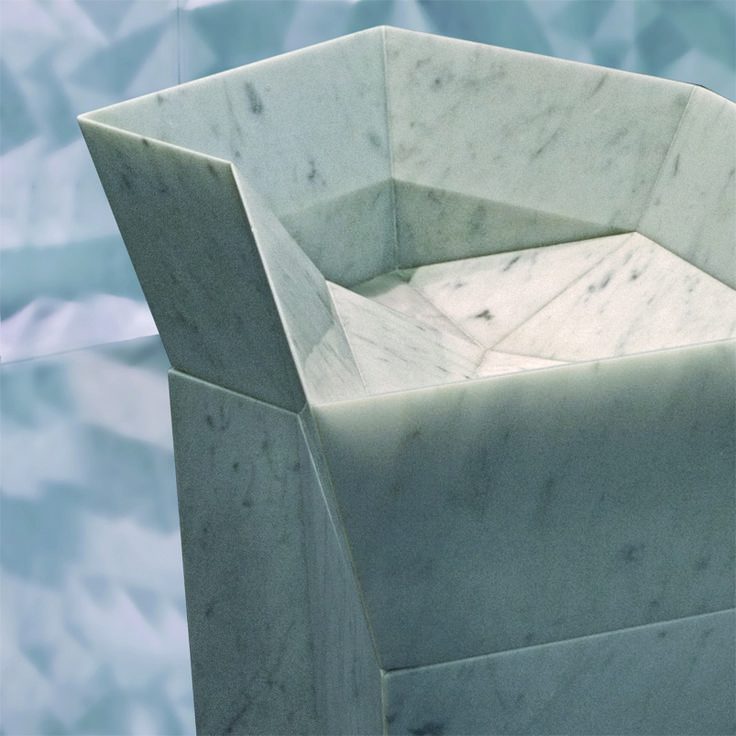 Hand Carved folded stone basin and wall panel. By Urban Edge Ceramics