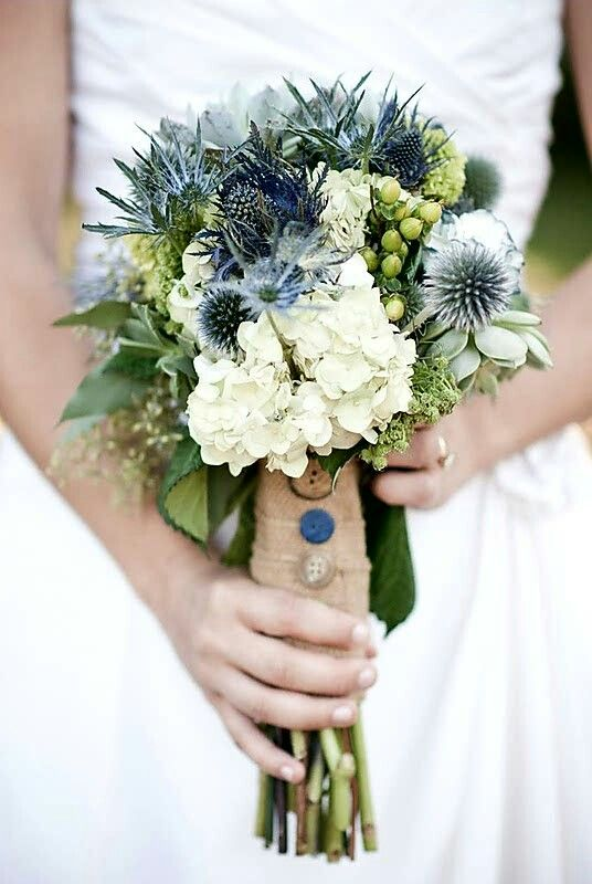 Rustic Wedding Bouquet Arranged With: White Hydrangea, Blue Eryngium Thistle, Blue Globe Thistles, Green Hypericum Berries, Green Eucalyptus Seeds & Green Foliage