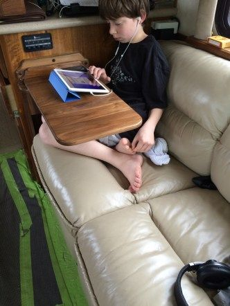 When we considered the possibility of living and working on board our RV, along with homeschooling two kids, we realized that a high priority for our family was going to be work space. A place to p…