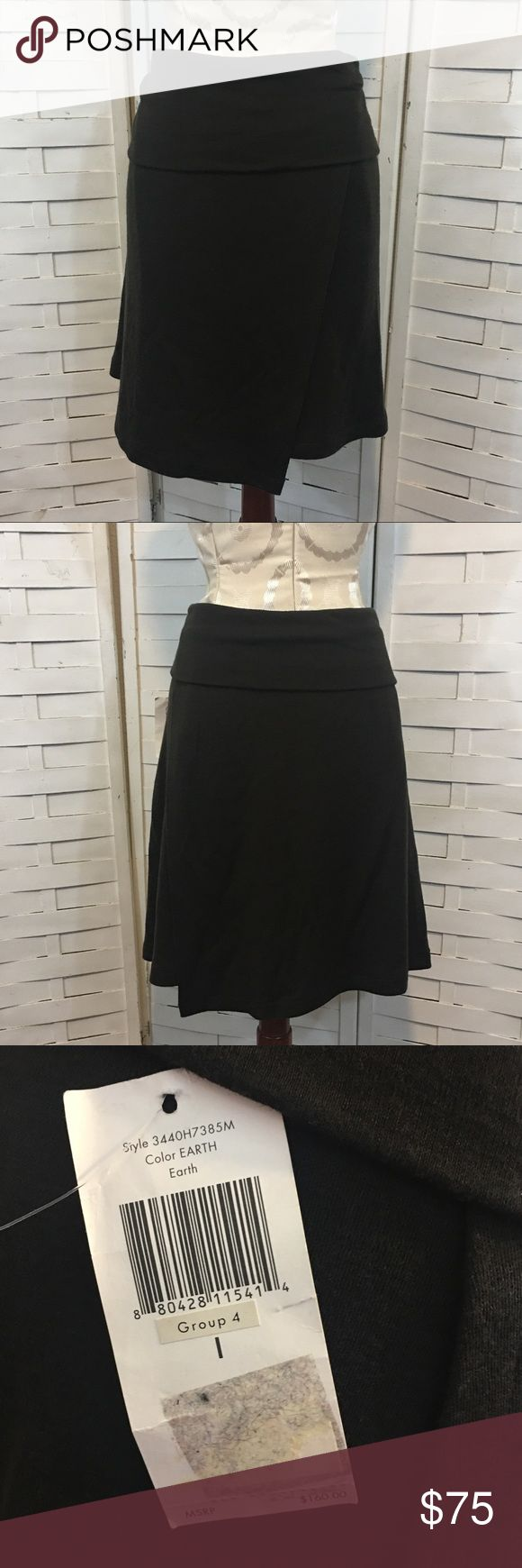 NWT Calvin Klein wool skirt N.365 New with tags attached skirt! Beautiful rich brown color! 100% wool! Gray for fall and winter. It has a unique asymmetrical hem and a fold over waist. No flaws. Calvin Klein Skirts