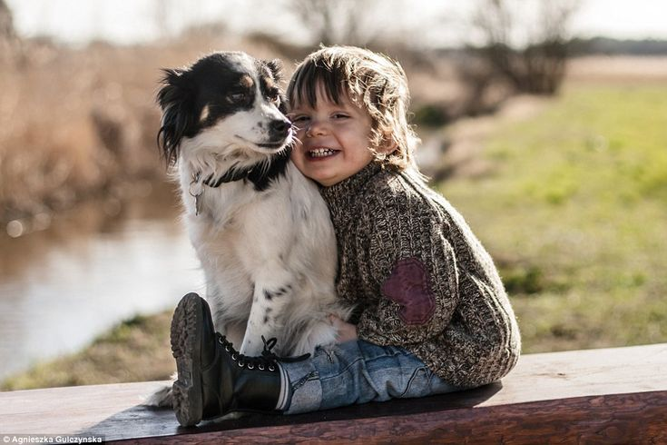 Igo sits comfortably with one of his dogs in one of the adorable images capturing their fr...