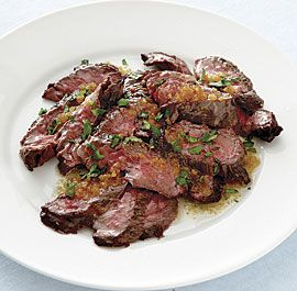 Brazilian Skirt Steak with Golden Garlic Butter | By: Leticia Moreinos Schwartz | Based on a dish you'll find in restaurants in Rio de Janeiro, this recipe uses few ingredients but packs a lot of bold flavor. | From: finecooking.com