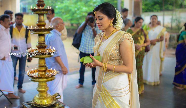 South Indian bride. Temple jewelry. Jhumkis.White silk kanchipuram sari.Kerala kasavu mundu set.Braid with fresh jasmine flowers. Tamil bride. Telugu bride. Kannada bride. Hindu bride. Malayalee bride.Kerala bride.South Indian wedding.