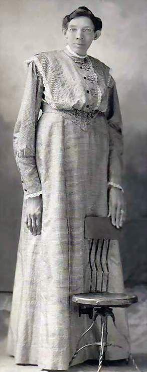 Ella Ewing - Missouri Giantess, reportedly stood 8 feet 4 1/2 inches tall. c. 1902