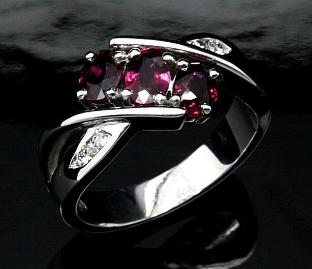 18ct. White Gold Ruby and Diamond Dress Ring.