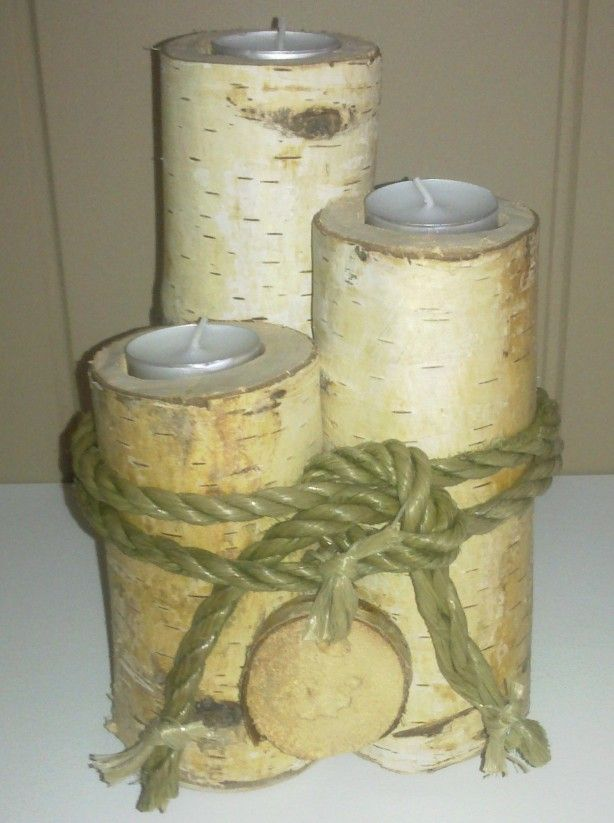 tealight holder of three birch trunks with speed drill 38 holes designed for tealights. rope around it and cut a slice of leftover birch.