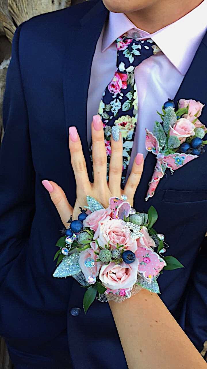 had the CUTEST corsage and boutonniere for Prom!!! #prom #corsage #boutonniere #pink #floral #navy #goals #pinkflowers #rhinestones #floraltie #pinknails #pinkandsilvernails #glitter #lightpink #navysuit #promcorsage