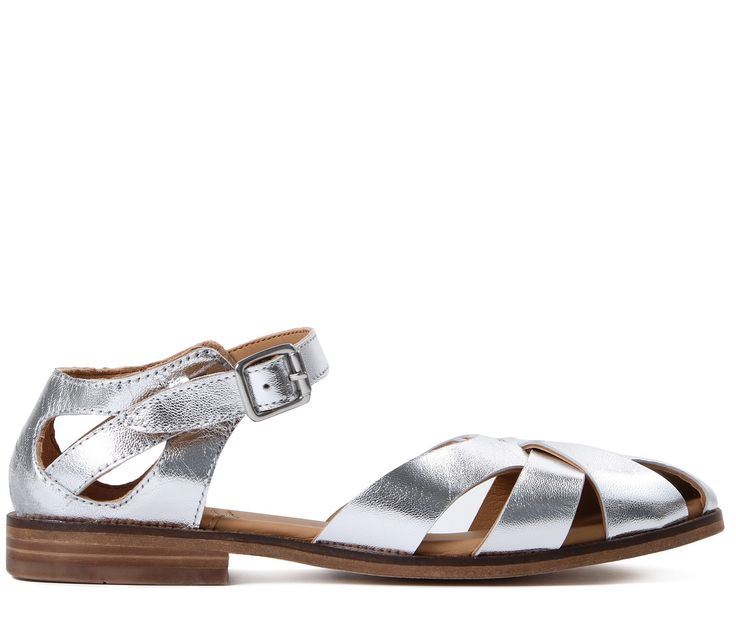 The Tilda sandal from the Spring Summer '17 Collection has been handcrafted in durable silver leather for a smooth transition into warmer climes. Featuring interlacing straps and a contrasting buckle, this feminine silhouette can be worn with a multitude for looks.