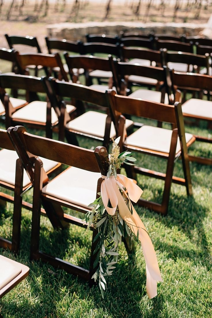wooden folding chairs for a rustic vineyard outdoor wedding ceremony | Rustic + Classic California Vineyard Wedding