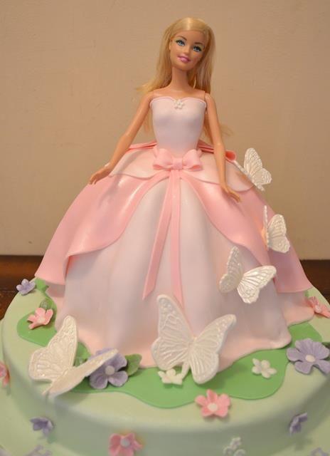 Lovely Barbie Cake.... beautiful fondant dress with butterflies around