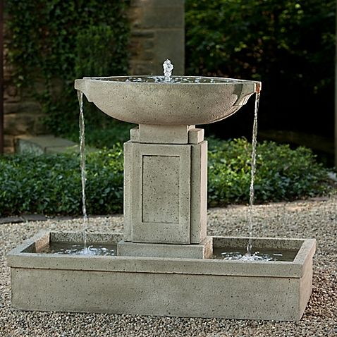The elegant, Art Deco-inspired Austin Outdoor Fountain from Campania is a pedestal fountain emerging from a large basin and trickling back down. Created of cast stone, this large, weather-resistant fountain brings sophistication to any yard.