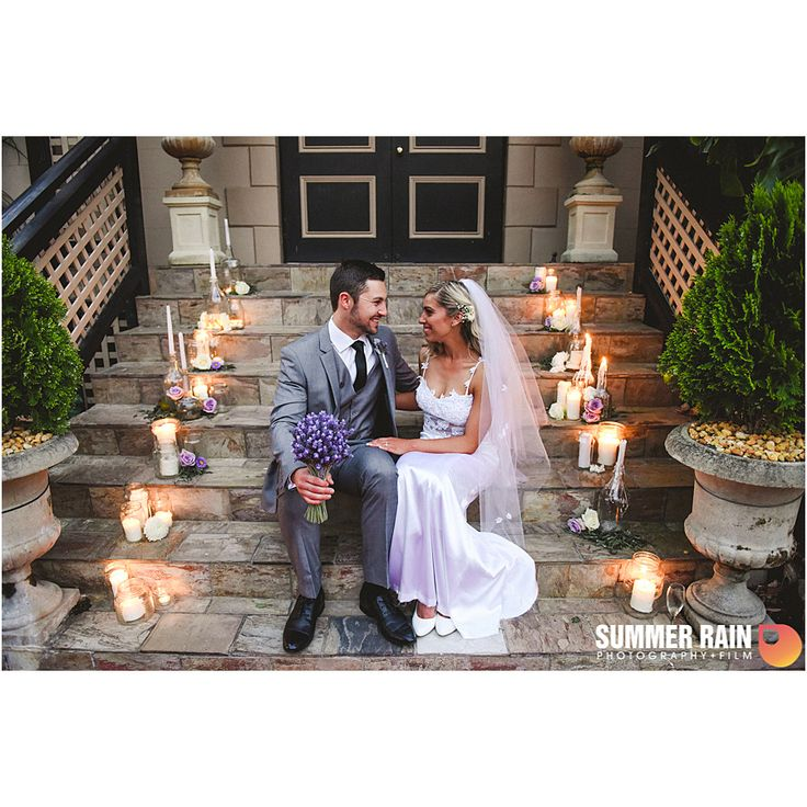 Beautiful wedding shot of Megan and Shannon | beautiful background of candles and elegant stairs | Photography by Summer Rain Photography