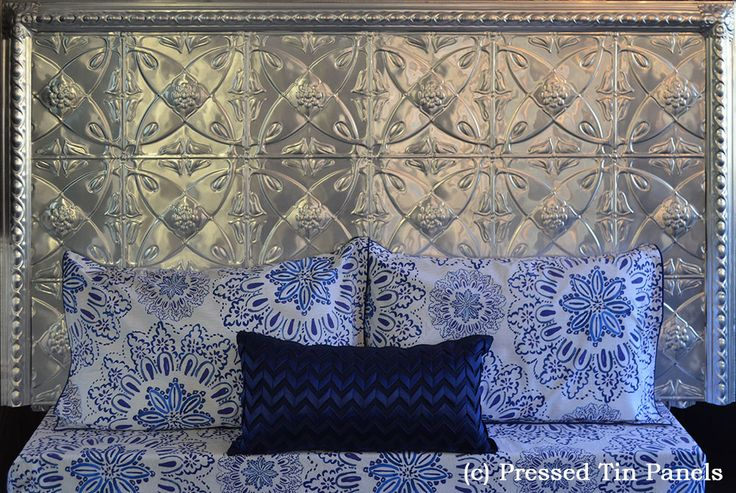A king size pressed tin panels bedhead made using the Carousel pattern, Egg Border and matching corner Rosettes