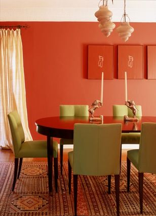 """Sherwin-Williams Tango Orange 6649.  """"Tango Orange is what I would call more of a mid-range orange, a current and hip color. I would use it for a focal wall in the living room or dining room; it would also be fun for an entryway."""""""