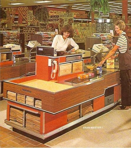 Grocery Store Checkout, 1970's. Notice all the different sizes of paper bags?