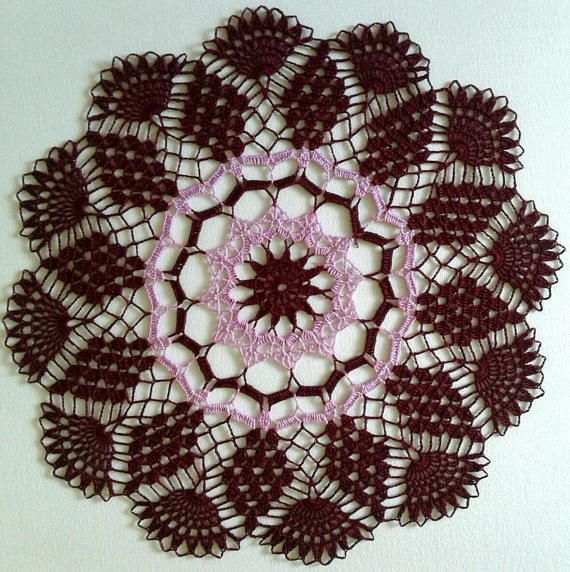 Handmade doily burgundy and pink approximately 15 inches in diameter