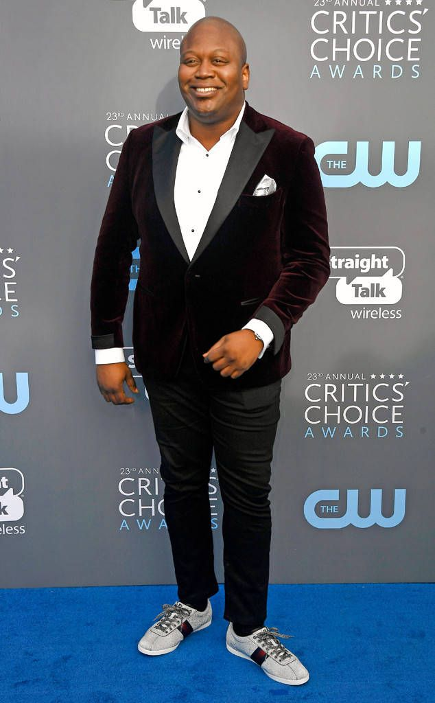 Tituss Burgess from 2018 Critics' Choice Awards Red Carpet Fashion  It's all about the details for the Unbreakable Kimmy Schmidt star who completes his outfit with a timepiece and cufflinks by Chopard.