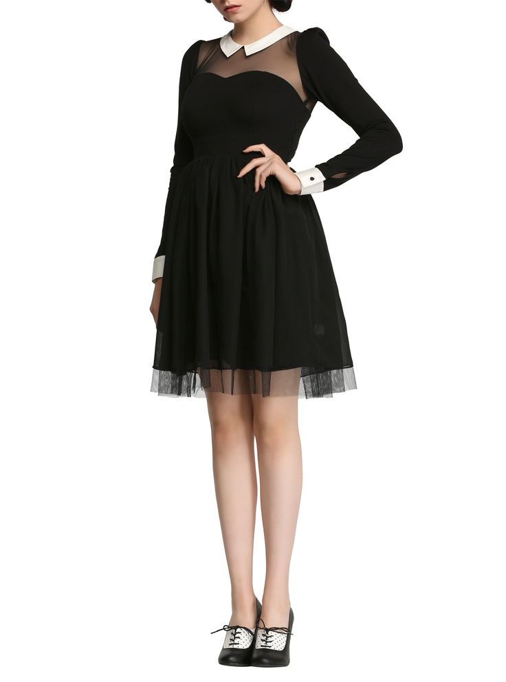 <p>Black maid-style dress from the Hot Topic exclusive <i>American Horror Story</i> collection with a white collar, sheer mesh sweetheart neckline and white trimmed sleeves. Side zipper closure.</p>  <ul> <li>100% polyester</li> <li>Wash cold; hang dry</li> <li>Imported</li> <li>Listed in junior sizes</li> </ul>