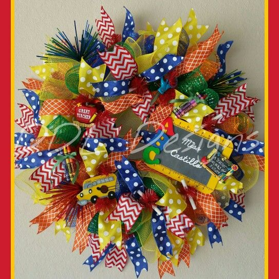 Bright primary colored Back to School Deco mesh wreath.  Http:/www.facebook.com/ddldesigns