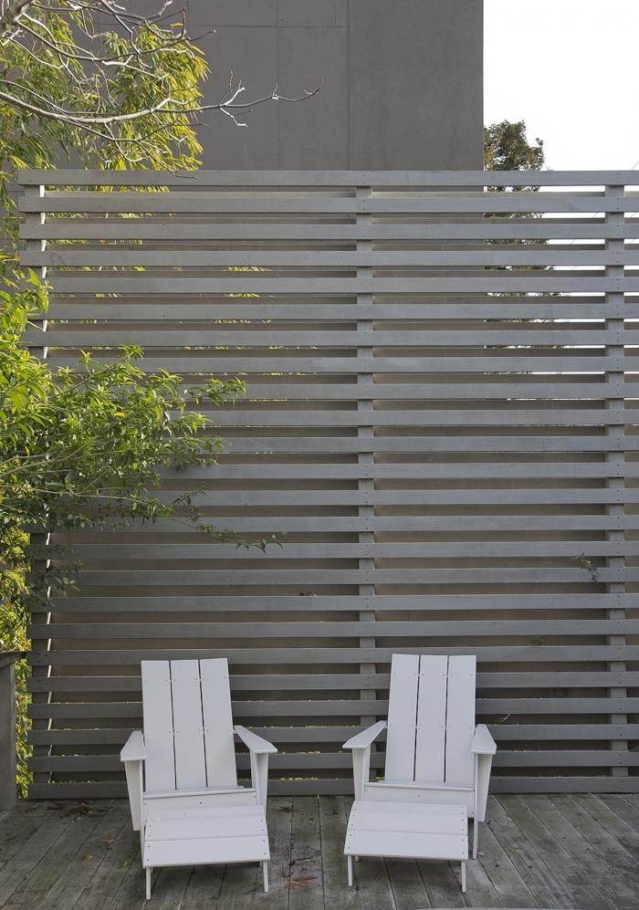 Potrero HIll home by Nilus Designs with wood slatted fence
