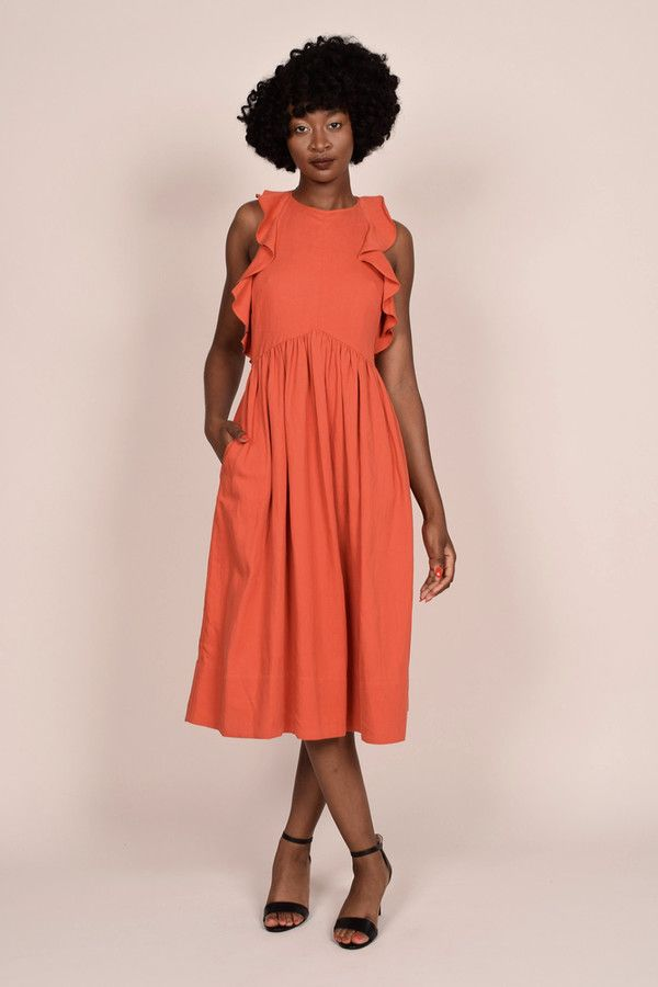 Ruffled twill midi dress with high neckline, adjustable back cross straps, center front pointed waist seam, hidden back zipper and side seam pockets Model is 5'10 and wearing a size 4. 48% Tencel 30% Linen 24% Cotton Dry Clean Imported