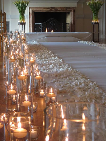 To make your wedding ceremony a more romantic feel and intimate, select clear-lit candles on both sides of the aisle, as well as white rose pedals. If your wedding is during the winter and around the holiday time, then this decor is perfect for your ceremony.