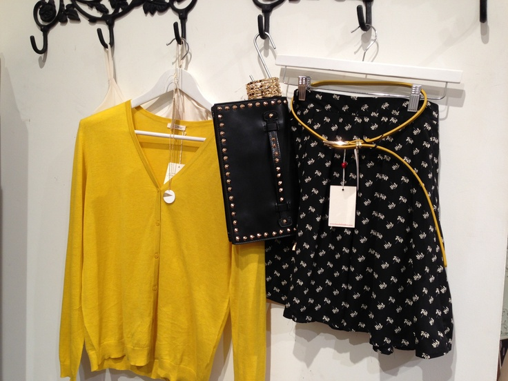 Pretty work look. Haze Skirt with Mustard Cardigan, Buckle Black Belt Black and Gold and Black Studded clutch  http://bowandpearl.com/new-in.html