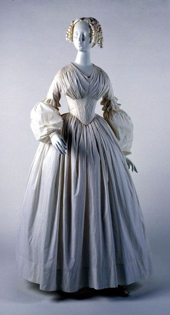 An American-made dress, ca. 1840. This unusual sleeve shape was in vogue from approximately 1837 to 1843