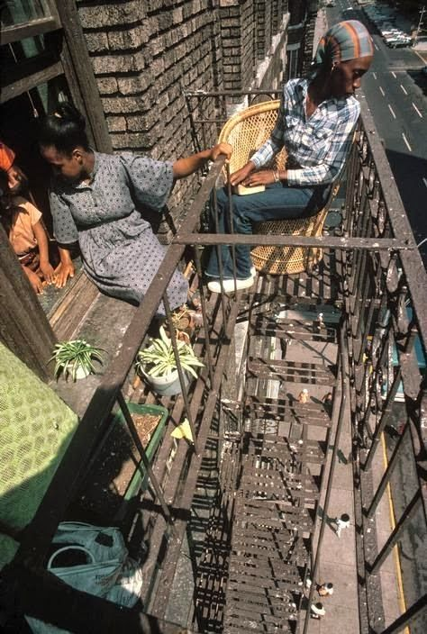 70s NYC: Sitting on the fire escape on 5th Avenue. Harlem, 1978