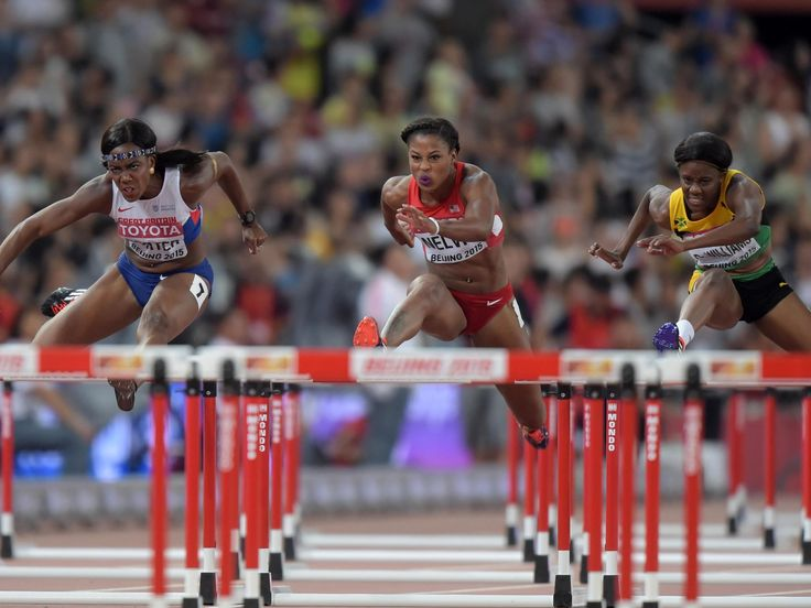 Danielle Williams (JAM), right, defeats Tiffany Porter (GBR), left, and Sharika Nelvis (USA) to win the women's 100m hurdles.  Kirby Lee, USA TODAY Sports