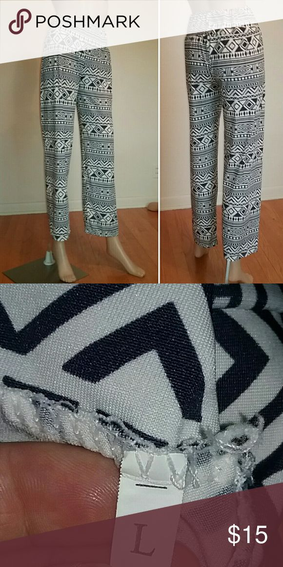 Navy and White Aztec Print Pants Beautiful aztec print pants in navy and white. Pairs beautifully with Pierre Cardin navy top. Pants