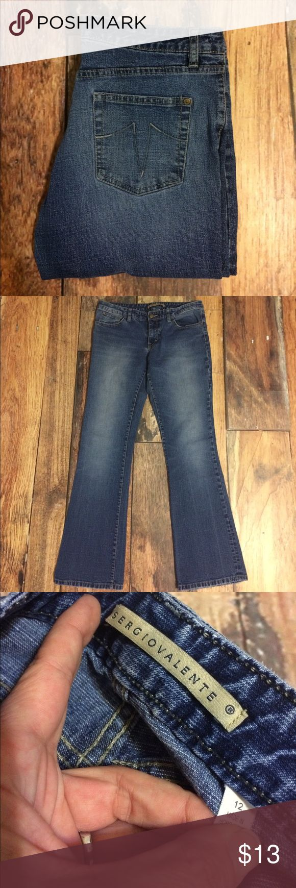 Sergio Valente Boot Cut Jeans Gently worn. Size 12 Sergio Valente Boot Cut Jeans. 90% cotton, 8% polyester, 2% spandex. Zip fly. 32 inch inseam. Picture five shows wear at bottom of jeans from foot drag. No rips, stains or tears. Non-smoking home. sergio valente Jeans Boot Cut