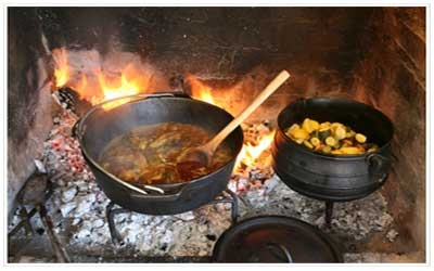 "Potjiekos (""food in a pot) - a stew made of any available meat and vegetables. This dish is traditionally cooked over a fire in a three legged cast iron pot. It originated with the Voortrekkers (pioneers) who travelled into the unknown interior of Southern Africa in the18th Century, in wagons pulled by oxen. Potjiekos is still one of the most popular dishes in South Africa today"