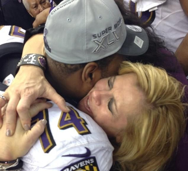 Leigh Ann Tuohy hugging her adopted son, Michael Oher, who won the Super Bowl last night (2013) playing for the Baltimore Ravens.